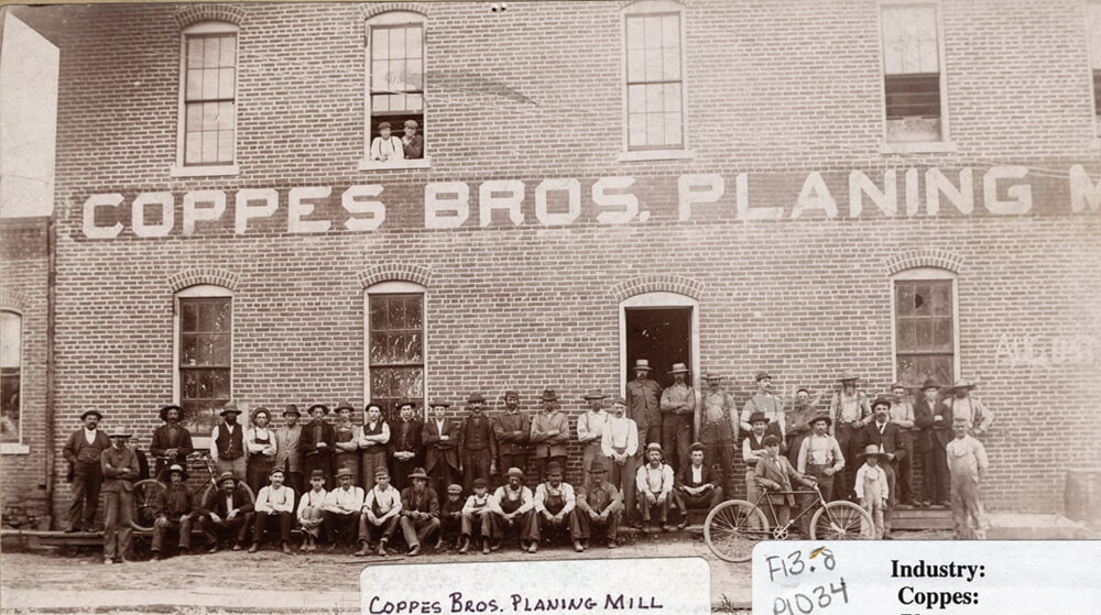 Coppes Employees with Two Bikes