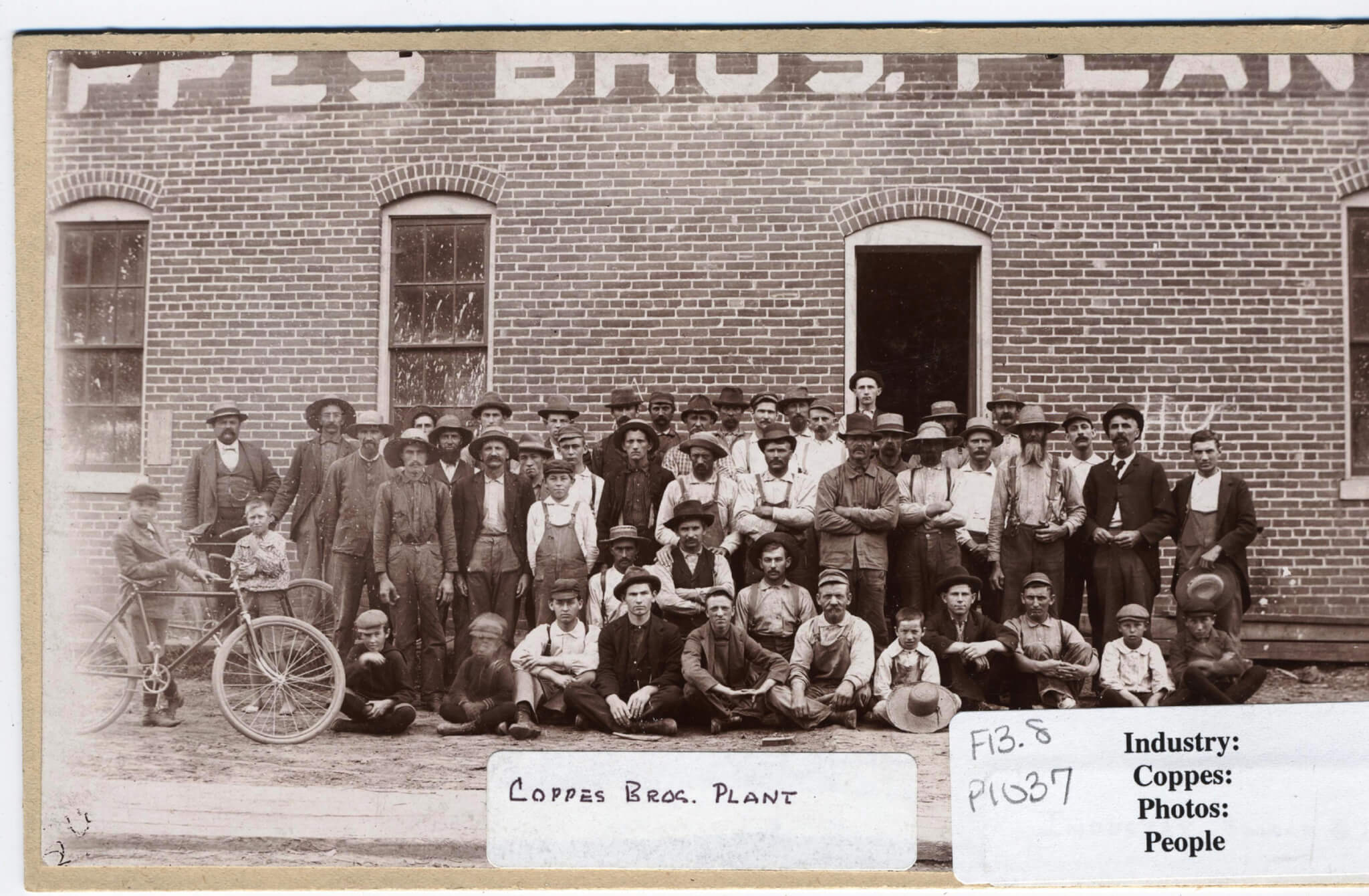 Early Coppes Employees with children and bicycle