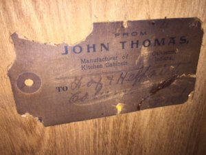 John Thomas Cabinet Tag