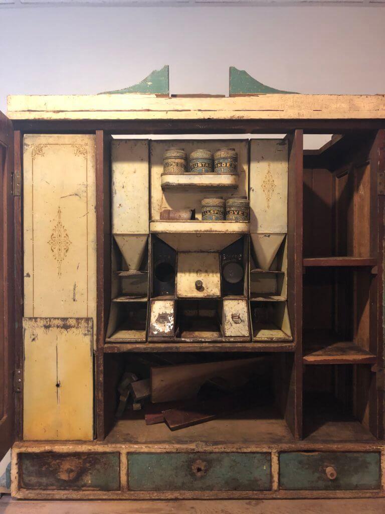tinware inside a custom Hoosier cabinet